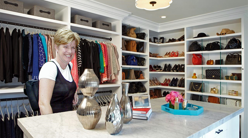 Betsy Hilliard in her NYC apartment's closet which is full of the best counterfeit handbags